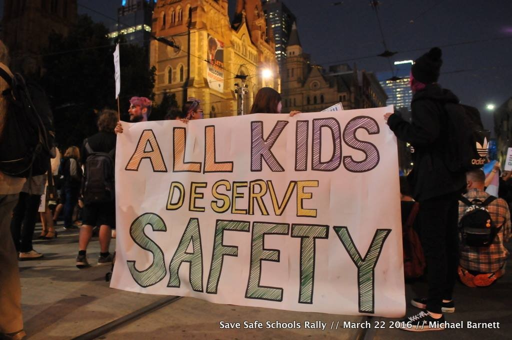 Banner says 'all kids deserve safety'