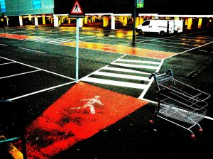 a shopping trolley on wet asphalt