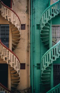 Two spiral staircases - one pink and one blue.