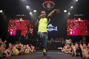 Dashaun Wesley wears a fluoro top as he vogues on the runway at Sissy Ball.