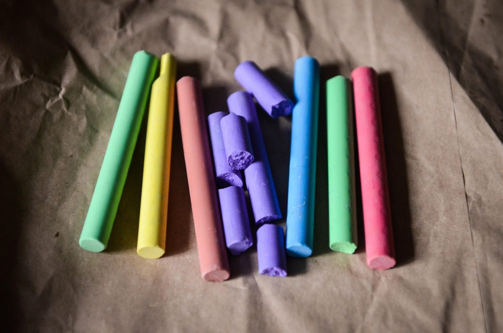 chalk is lined up in rainbow colours