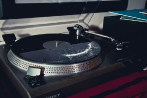 a white powder lines the crevice of a record in a record player