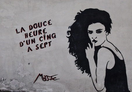 Street art depicting a person holding a finger to their lips and words in French