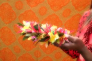 Colourful flowers held in hands
