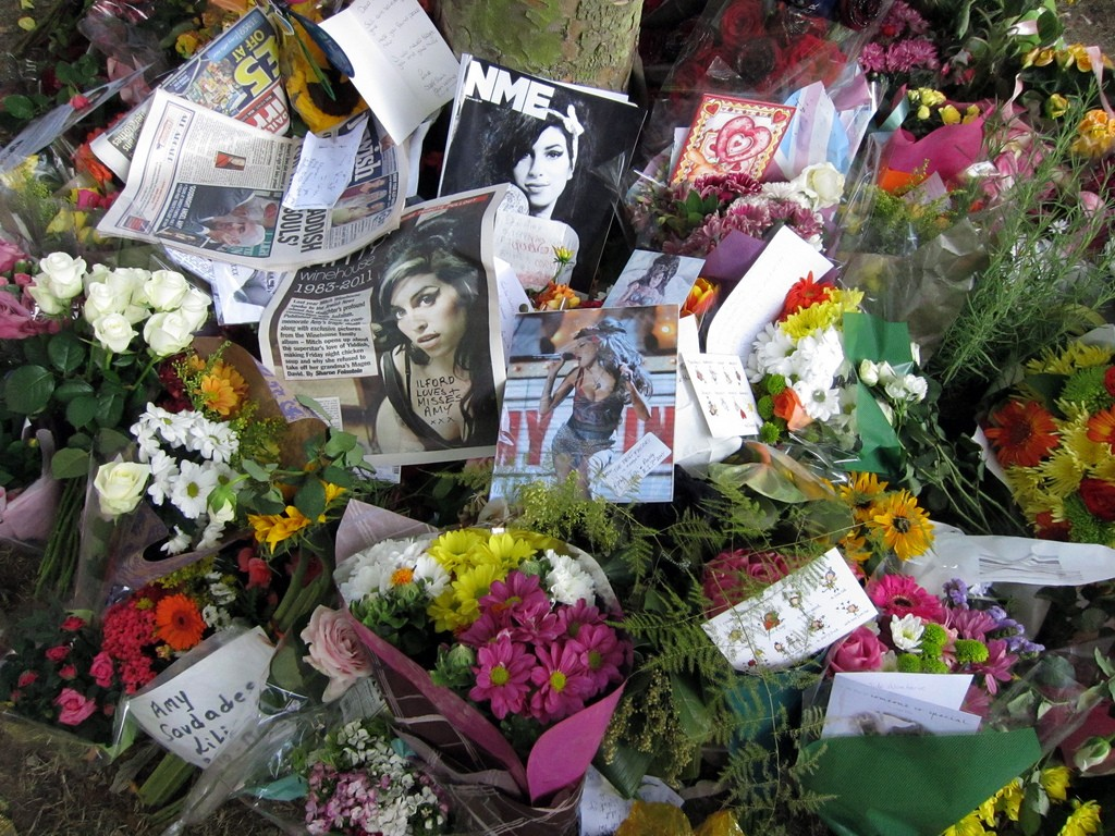 Tributes and flowers left outside Amy Winehouse's home.